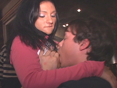 Hot brunette sucking and screwing dick at a club party while people are encouraging her!